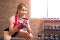 Woman with kettlebell Stock Image