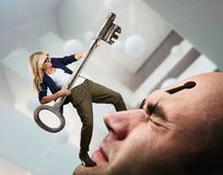 Woman with key on the man's face Stock Photography