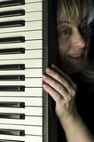 Woman With A Keyboard Stock Images