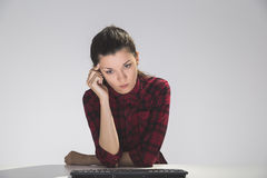 Woman with keyboard is thinking Stock Photography