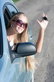 Woman with keys. Young woman with keys of the car Royalty Free Stock Photo