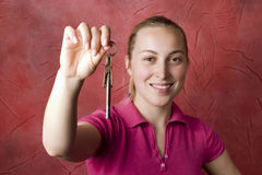 Woman with keys stock photos