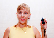 Woman with keys. Blonde woman with car keys in hand Royalty Free Stock Image