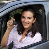 Woman with keys in a car Stock Images