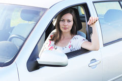 Woman with keys in a car Royalty Free Stock Image