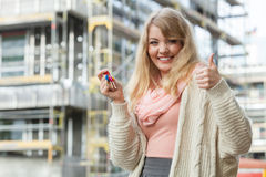 Woman with keys on front of new house building Royalty Free Stock Photography