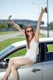 Woman with keys and lisence near her car Stock Image