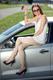 Woman with keys and lisence near her car Royalty Free Stock Photo