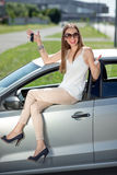 Woman with keys and lisence near her car Royalty Free Stock Photos