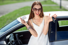 Woman with keys and lisence near her car Royalty Free Stock Images