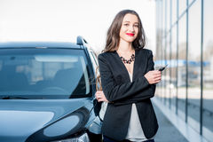 Woman with keys near the car Royalty Free Stock Image