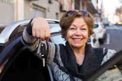Woman with keys near car Stock Photo