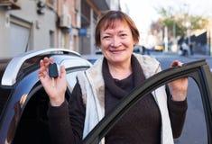 Woman with keys near car Stock Image