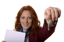 Woman with keys smiling Royalty Free Stock Photo