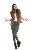 Woman In Khaki Pants And Fur Vest Showing Thumbs Up Royalty Free Stock Images