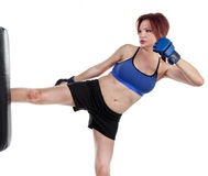 Woman Kick Boxer with Punching Bag Royalty Free Stock Photography