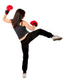 Woman kick boxing action Royalty Free Stock Photos
