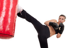 Woman kick a punching bag Stock Image