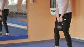 Woman kickboxer is training in a sports studio with dumbbells. 4k stock video