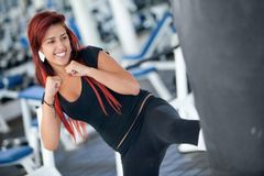 Woman kickboxing Royalty Free Stock Image