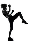 Woman kickboxing posture boxer boxing. One woman exercising workout fitness aerobic exercise posture on studio isolated white background stock photo