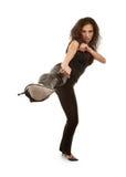 Woman kicking Stock Image
