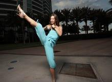 Woman kicking Royalty Free Stock Images