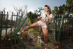 Woman kicking the fence Stock Images