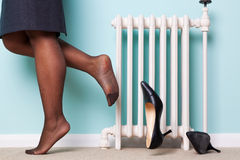 Woman kicking her heels off royalty free stock photography