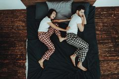 Woman is Kicking Snoring Man on Bed stock photos