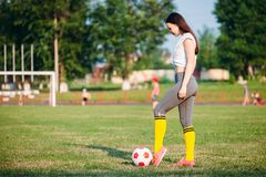 Woman kicking soccer ball royalty free stock photography