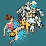 The woman kicks an astronaut family quarrel. Pop art retro vector illustration comic cartoon kitsch drawing Stock Images