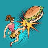 Woman kicks Burger, fastfood and healthy food. Pop art retro vector illustration comic cartoon kitsch drawing Royalty Free Stock Image