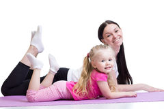 Woman and kid girl exercising together. Healthy Stock Photo