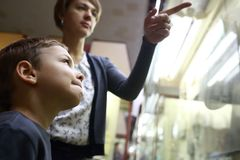 Woman with kid in museum Stock Image