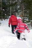 Woman and kid snowshoeing Royalty Free Stock Images