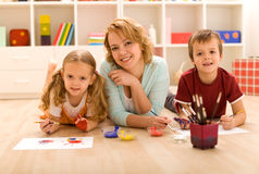 Woman and kids doing heavy artwork Stock Photos