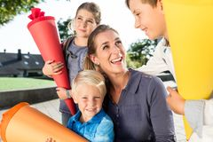 Woman and kids at enrolment day with school cones Stock Images