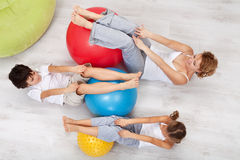 Woman and kids exercising together Stock Photo