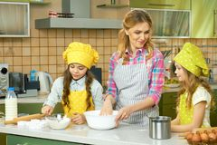 Woman with kids, kitchen. Stock Image