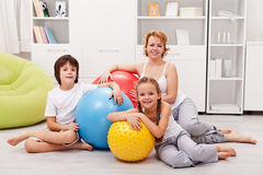 Woman and kids ready for gymnastic - sitting on the floor Royalty Free Stock Image
