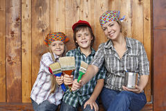 Woman with kids ready to paint the shed Royalty Free Stock Photography