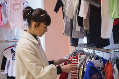 Woman in kids shop Stock Image