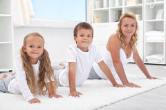 Woman and kids stretching their backs Stock Image