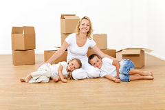 Woman with kids in their new big home Stock Images