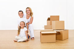 Woman and kids unpacking in their new home Stock Photography
