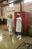 Woman at Killing floor site at Nyongara slaughterhouse in Nairobi, Kenya, Africa Stock Image