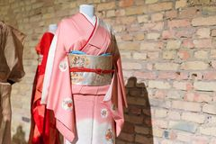 Woman Kimono costumes on mannequins. Traditional Japanese Samurai and Maiko dresses. Geisha clothing. Woman Kimono costumes on mannequins. Traditional Japanese Royalty Free Stock Photos