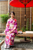 Woman with kimono dress and sitting in tea house Royalty Free Stock Photo