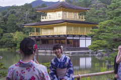 Woman in Kimono in front of Golden Temple Pavilion Royalty Free Stock Images